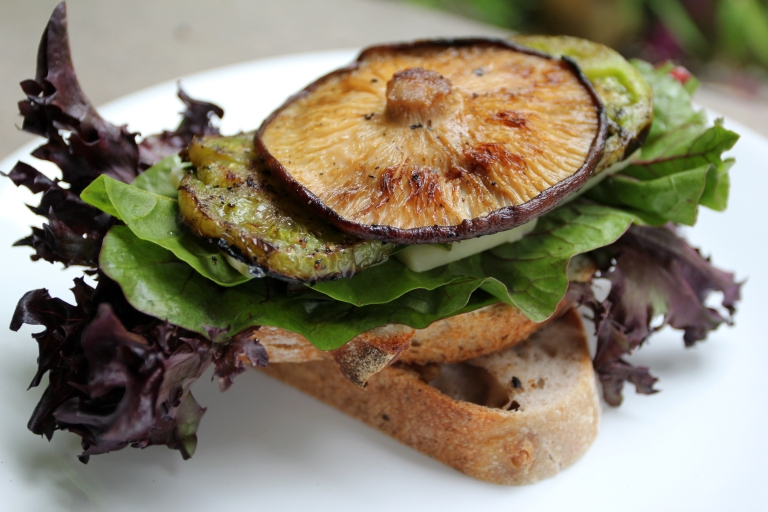 Grilled green tomato and shiitake mushroom sandwich on cherry walnut sourdough